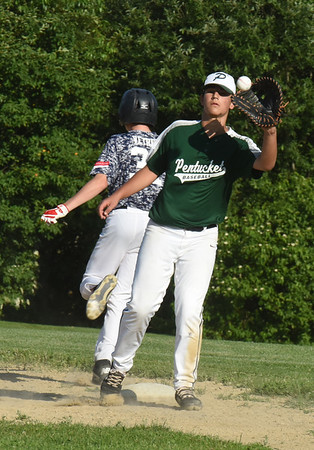 BRYAN EATON/Staff photo. The throw is late to Pentucket first baseman Alex Robertson allowing Triton's Owen Vetree the plate.