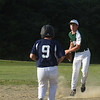 BRYAN EATON/Staff photo. Pentucket shortstop Trevor Kamuda forces out Hamilton-Wenham's and tries for a double.