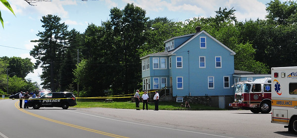 BRYAN EATON/Staff Photo. State and local officials were at the home of Sam Racioppi as he received a suspicious package at his home at 8 Main Street in Salisbury on Monday afternoon. Two other people in the state received similar packages.