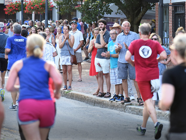 BRYAN EATON/Staff Photo. Spectators cheer on runners in the Lion's Club 5K and 10-Mile Road Race as they run through Market Square.
