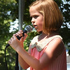 "BRYAN EATON/Staff Photo. Emmalina Zirpolo, 7, of Hampstead, N.H. sings ""What a Wonderful World"" made famous by Louis Armstrong."