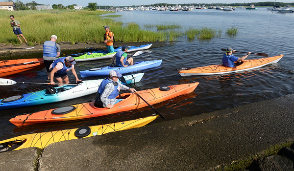 BRYAN EATON/Staff Photo. Kayakers enter the Merrimack River for the Kayak and SUP Races at Cashman Park on Saturday.