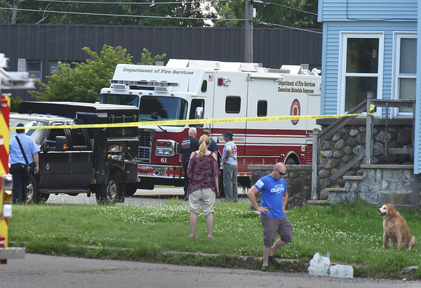BRYAN EATON/Staff Photo. State and local officials were at the home of Sam Racioppi, right, as he received a suspicious package at his home at 8 Main Street in Salisbury on Monday afternoon. Two other people in the state received similar packages.