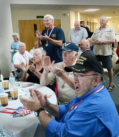 BRYAN EATON/Staff Photo. Members of each branch of the U.S. military clapped to the theme of their branch, in this case, veterans of the U.S. Navy.