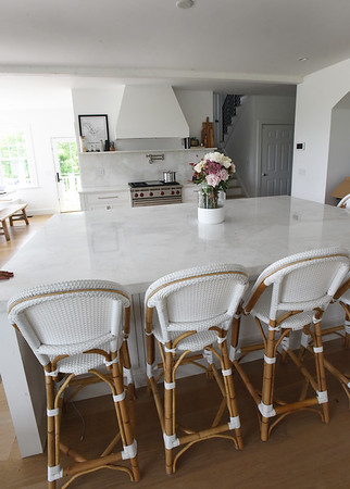BRYAN EATON/Staff Photo. A large island is a great gathering place in the kitchen where guests inevitably congregate in.