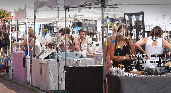 BRYAN EATON/Staff Photo. Many handmade goods were available a the Market Square Craft Show.