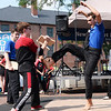BRYAN EATON/Staff Photo. Gareth Buhl of the Dojo Martial Arts School in Salisbury breaks wooden board, and concrete ones as well, at a demonstration in Market Square.