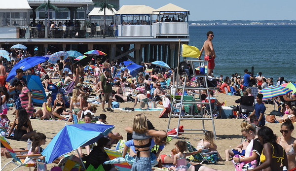 BRYAN EATON/Staff photo. Salisbury Beach was packed with sun worshippers on the first weekend of summer as the temperature was in the mid-80's on Sunday afternoon. The rest of the week looks sunny and seasonable except for Tuesday when rain is in the forecast.