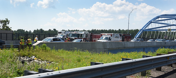 BRYAN EATON/Staff Photo. Several vehicles were involved in a crash on the north side and the northbound lane of the Whittier Bridge on  Insterstate 95 on Wednesday morning. Police said there were no injuries.