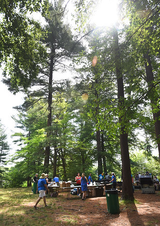 BRYAN EATON/Staff photo. The sun was shining through the namesake pines at Amesbury Town Park for the Pancakes in the Pines on Independence Day.