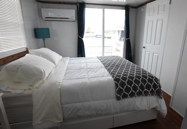 BRYAN EATON/Staff Photo. The houseboat has air conditioning in the sleeping quarters as well as the living area.