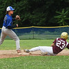 BRYAN EATON/Staff photo. Georgetown's Joseph Williams has the ball, but Newburyport's Lawton is called safe.
