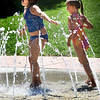 BRYAN EATON/Staff Photo. Friends Mia Connolly, left, and Ivy Olsen, both 7, of Amesbury cool off at the water park at Amesbury Town Park on Tuesday afternoon. The spot should be popular through the holiday weekend as temperatures are forecast to touch the 90's at the end of the week.