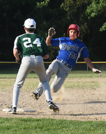 BRYAN EATON/Staff photo. Georgetown's Jack Lucido hits a triple as Pentucket third baseman Derek Tardy waits for the throw.