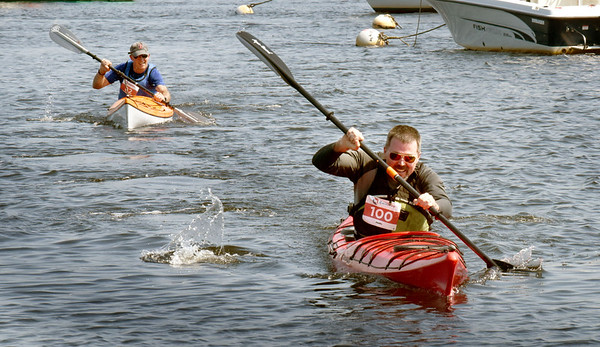 BRYAN EATON/Staff Photo. First to cross in the recreational kayak division is Dan Driscoll of Newburyport.