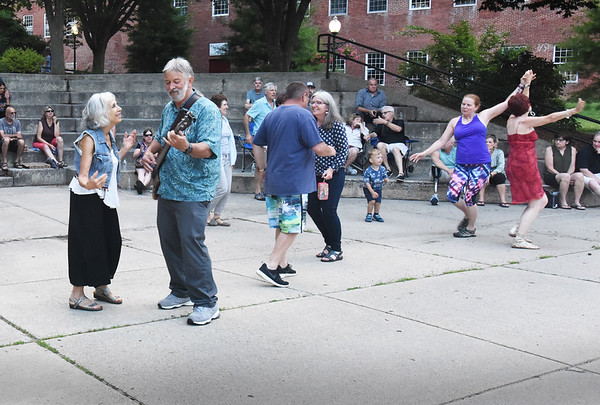 BRYAN EATON/Staff Photo. People dance to the music of The Bob Kramer Band at the amphitheatre in Amesbury's Upper Millyard on Friday night. The show was part of the Amesbury Chamber of Commerce and Industries. PowWow Summer series featuring music, movies, kids activities and more.