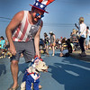 "BRYAN EATON/Staff photo. The description for the Annual Pet Parade at Salisbury Beach says ""dress your pet in a fun costume, beach attire, patriotic gear, or bring them au natural."" Chris Samperi of Merrimack, N.H., whose mother lives at Salisbury Beach, took heed of the patriotic theme and dressed up Buddy as Uncle Sam."