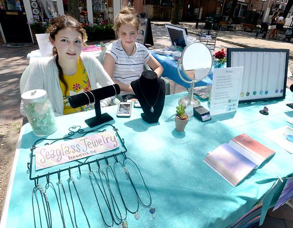 BRYAN EATON/Staff Photo. Tessa Porter, left, and Birima Tanona, both 13, sell their handmade jewelry through the Newburyport Youth Services on Inn Street.