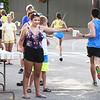 BRYAN EATON/Staff Photo. Volunteers hand out water to the Lion's Club 5K and 10-mile road race on Water Street in Newburyport.