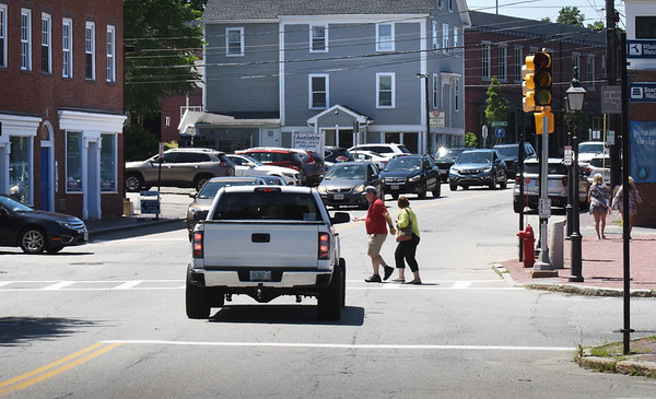BRYAN EATON/Staff Photo. The traffic lights at Merrimac and Green Street in downtown Newburyport have not been functioning for the last couple weeks.