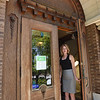 BRYAN EATON/Staff Photo. Library archivist Meghan Petersen opens the front doors to the Amesbury Public Library which are due for a complete and thorough renovation.