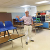 BRYAN EATON/Staff Photo. Building committee member Peter Hoyt in the fourth grade classroom he taught.