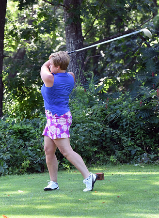 BRYAN EATON/Staff Photo. Marge Parker of Dorchester, playing with friends from Newburyport in the Geno Open at Ould Newbury Country Club, tees off.