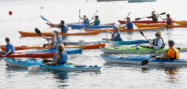 BRYAN EATON/Staff Photo. The recreational kayakers begin the Kayak and SUP Races at Cashman Park.