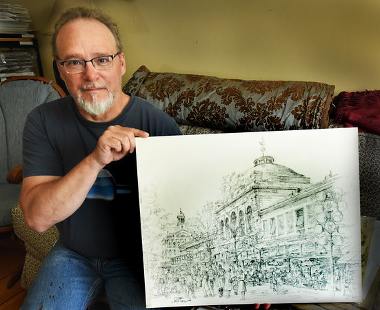 BRYAN EATON/Staff Photo. John Brown, who runs the artists revival at Yankee Homecoming, has been in communication with Jillson Frost, Jack Frost's grandaughter. Jack Frost launched Yankee Homecoming many years ago and was an artist, his artwork here of Faneuil Hall in Boston.