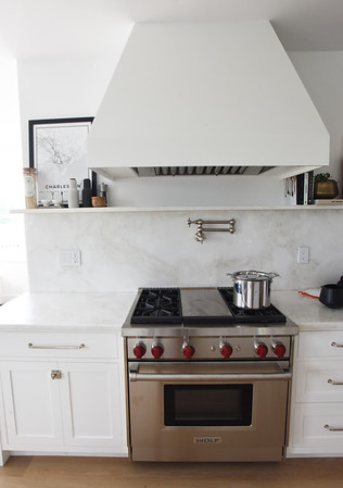 BRYAN EATON/Staff Photo. A huge vent tops the stainless steel stove.