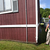 BRYAN EATON/Staff Photo. Amesbury schools Superintendent Jared Fulgoni checks out the portable classrooms, also known as the condos, at Amesbury Elementary School which were installed in 1995 and only to be used for five years.
