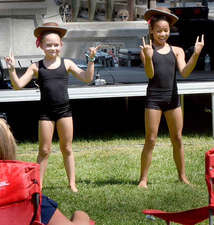 "BRYAN EATON/Staff Photo. Donning cowboy hats for part of their dance routine, Molly Maynard, 8, left, and Ella Treitel-Poore, 10, both of Salisbury, perform to the newly popular song ""Old Town Road."""