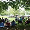 BRYAN EATON/Staff photo. With the temperature at 94 degrees and high humidity, many festival goers parked their chairs under the trees at Waterfront Park.