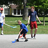 BRYAN EATON/Staff Photo. Campers and counselors in the Amesbury Recreation Departments Summer Youth Park Program play street hockey at the Amesbury Town Park on Tuesday afternoon. The program started for the season with more programs at different locations begin next week.