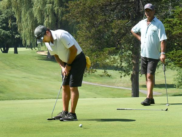BRYAN EATON/Staff Photo. Eddie Shelley of Newburyport makes this put in the Geno Open Golf Tournament.