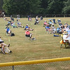 BRYAN EATON/Staff photo. West Newbury held its town meeting outdoors on Saturday, with some sitting the town annex parking lot and many in the ballfield adjacent to it.