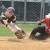 JIM VAIKNORAS/Staff photo Amesbury's Alexis Boswell slide into 3rd just under the tag of St Mary's Molly Mello during the North Final at Martin Field in Lowell Sunday. The Indians lost the game 8-4.