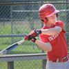 BRYAN EATON/Staff Photo. Dalton Dow gets a single in practice.