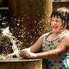 BRYAN EATON/Staff Photo. Violet Aldrich, 6, of Newburyport reacts as the fountains on Inn Street in Newburyport shot back on after receding for a couple seconds. She was there Wednesday afternoon with her mother Korki who thinks the new fountains are wonderful for the downtown.