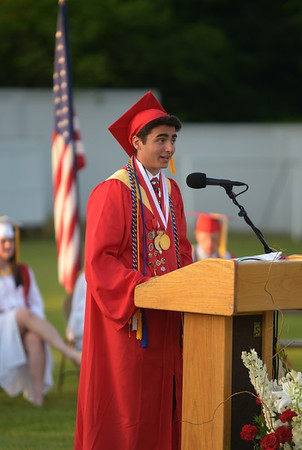 JIM VAIKNORAS/Staff photo Christopher Cioffi gives the Valedictorian address at Amesbury high graduation at Landry Stadium Friday night.