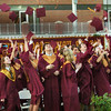 BRYAN EATON/Staff Photo. Newburyport High School graduates toss their mortarboards in the air as the end of ceremonies.