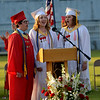 JIM VAIKNORAS/Staff photo Seniors Eli Ratner, Amy Snyder, and Haley Gendell sing the National Anthem Amesbury high graduation at Landry Stadium Friday night.