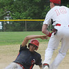 BRYAN EATON/Staff Photo. Amesbury third baseman Incontri waits for the throw as a Charlestown player is safe.