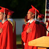 JIM VAIKNORAS/Staff photo Seniors Robert Cahill and James Fiers Jr, who will both be joining the Marine Corp after graduation recite the Pledge of Allegiance Amesbury high graduation at Landry Stadium Friday night.