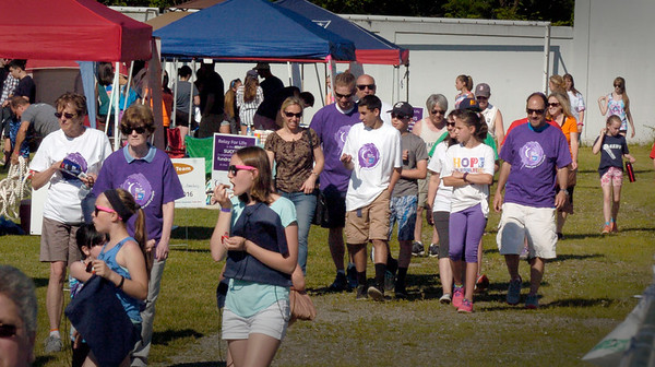 """BRYAN EATON/Staff Photo. The local Relay For Life kicked off at Landry Stadium in Amesbury on Saturday afternoon and went for fourteen hours. The annual event raises money and awareness for the American Cancer Society with this year's theme """"Remember, Celebrate and Fight Back."""""""