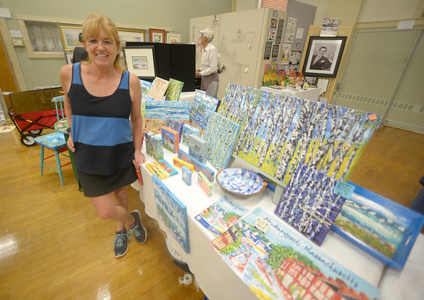 JIM VAIKNORAS/Staff photo 6/24/2016 Sandra Morrissey with some of her art at the Amesbury Days Art Show at City Hall in Amesbury.