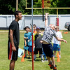 JIM VAIKNORAS/Staff photo 6/24/2016 Gage Nelson shows off his verticle jump as Amesbury High football player Zach Levarity during a youth football combine at Landry Stadium in Amesbury.