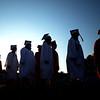 JIM VAIKNORAS/Staff photo Seniors march into Landry Stadium at the start of Amesbury high graduation Friday night.
