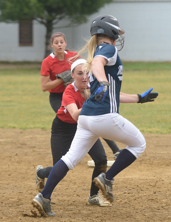 JIM VAIKNORAS/Staff photo Amesbury's Lauren Fedorchak tags a runner as she turns a double play against Mount Alvernia at Chris Perry Field in Amesbury Sunday. The Indian's won the game 9-2.