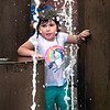 BRYAN EATON/Staff photo. Devyn Ray, 5, of Salisbury cools off from Wednesday's heat and humidity in the Inn Street fountain in Newburyport on a visit with her sister, Kyle, 4, and mother. The holiday weekend looks good with showers likely Friday night ending early Saturday.